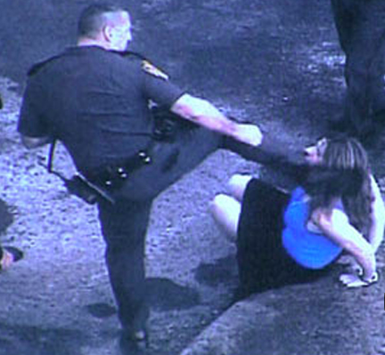 Lincoln, R.I. cop Edward Krawetz kicks Ms. Donna Levesque in face while handcuffed. May 31, 2009.